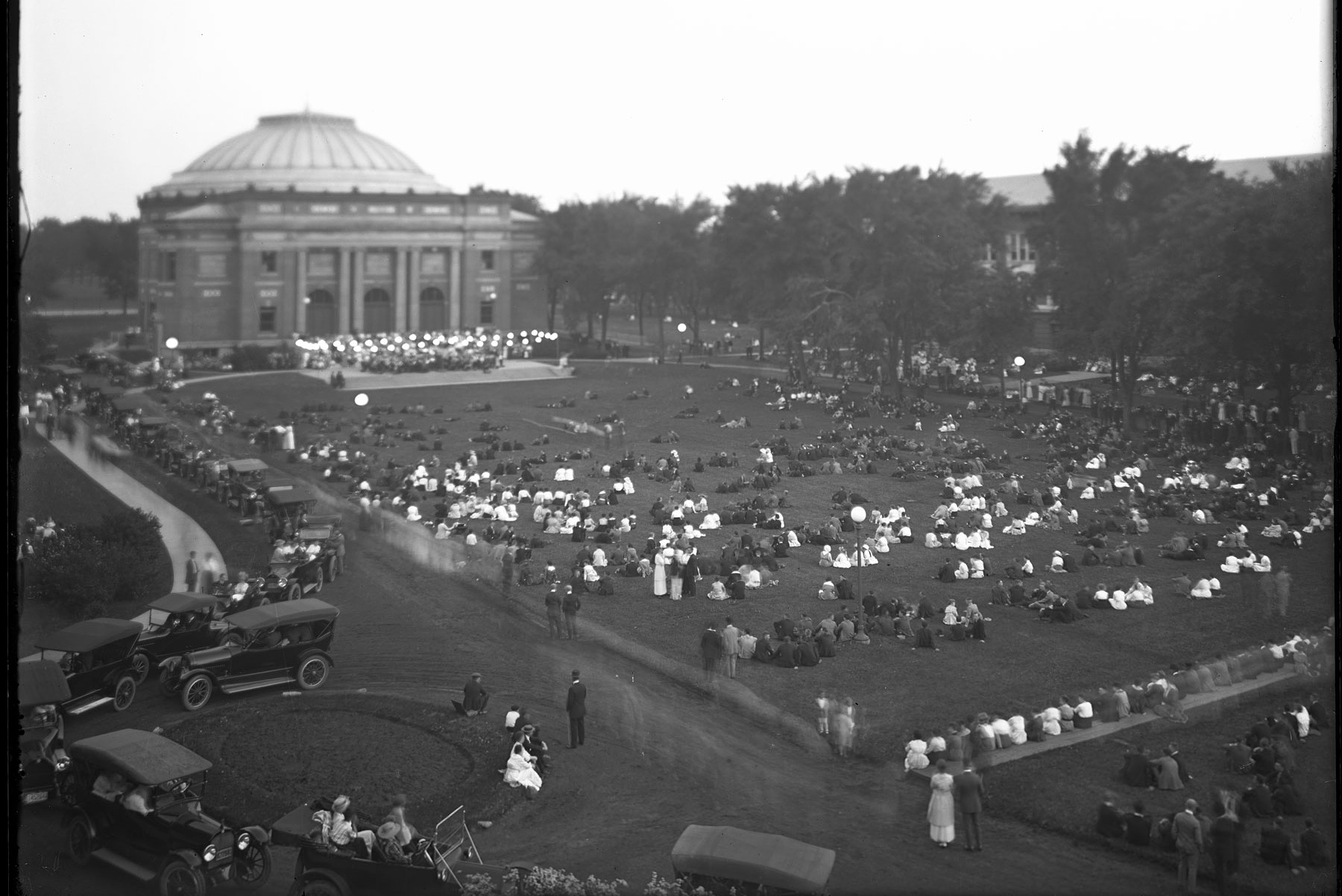 a band plays outside Foellinger Auditorium in the summer of 1916